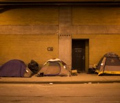 Tents on Lower Wacker Drive provide shelter for homeless people. The visible tags have the date and time of the next sanitation sweep. Photo by Saiyna Bashir